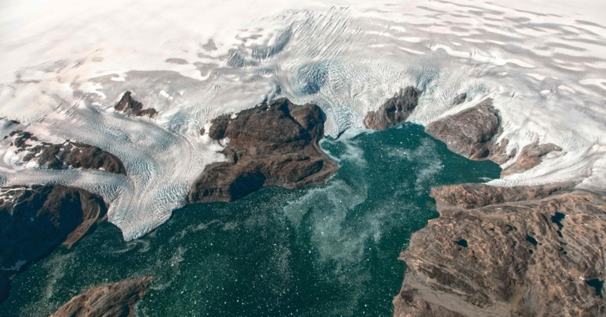 This NASA Earth Observatory file photo taken on September 22, 2016 and observed from the HU-25A Guardian aircraft shows the Bruckner and Heim glaciers where they flow into Johan Petersen Fjord in southeastern Greenland. (AFP Photo)