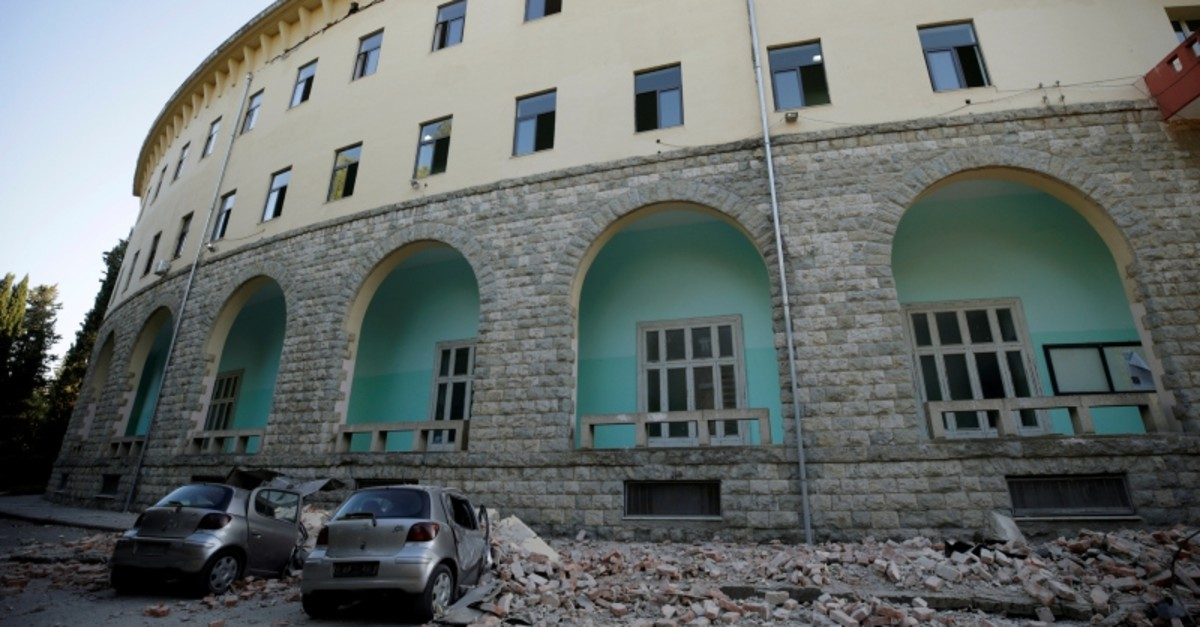 Destroyed cars stand next to a damaged building after an earthquake in Tirana, Albania, Sept. 21, 2019 (Reuters Photo)