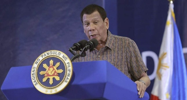 In this Jan. 23, 2020, photo provided by the Malacanang Presidential Photographers Division, Philippine President Rodrigo Duterte delivers his speech at the San Isidro Central School during the distribution of benefits to former rebels in Leyte province, southern Philippines. Malacanang Presidential Photographers Division via AP