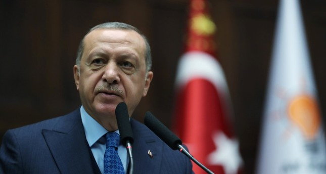 President Recep Tayyip Erdoğan, the chairman of the AK Party, gestures to his supporters as he speaks during his party's parliamentary group meeting at the Grand National Assembly of Turkey in Ankara, Dec. 25.