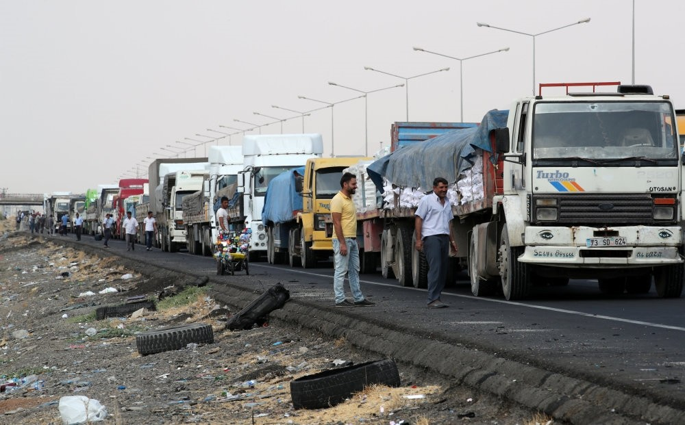 Trucks wait in line to pass Habur border gate near the town of Silopi at the Turkish-Iraqi border.