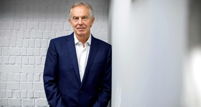 Former British Prime Minister Tony Blair poses for a photograph ahead of an interview with AFP in central London on July 17, 2018. (AFP Photo)