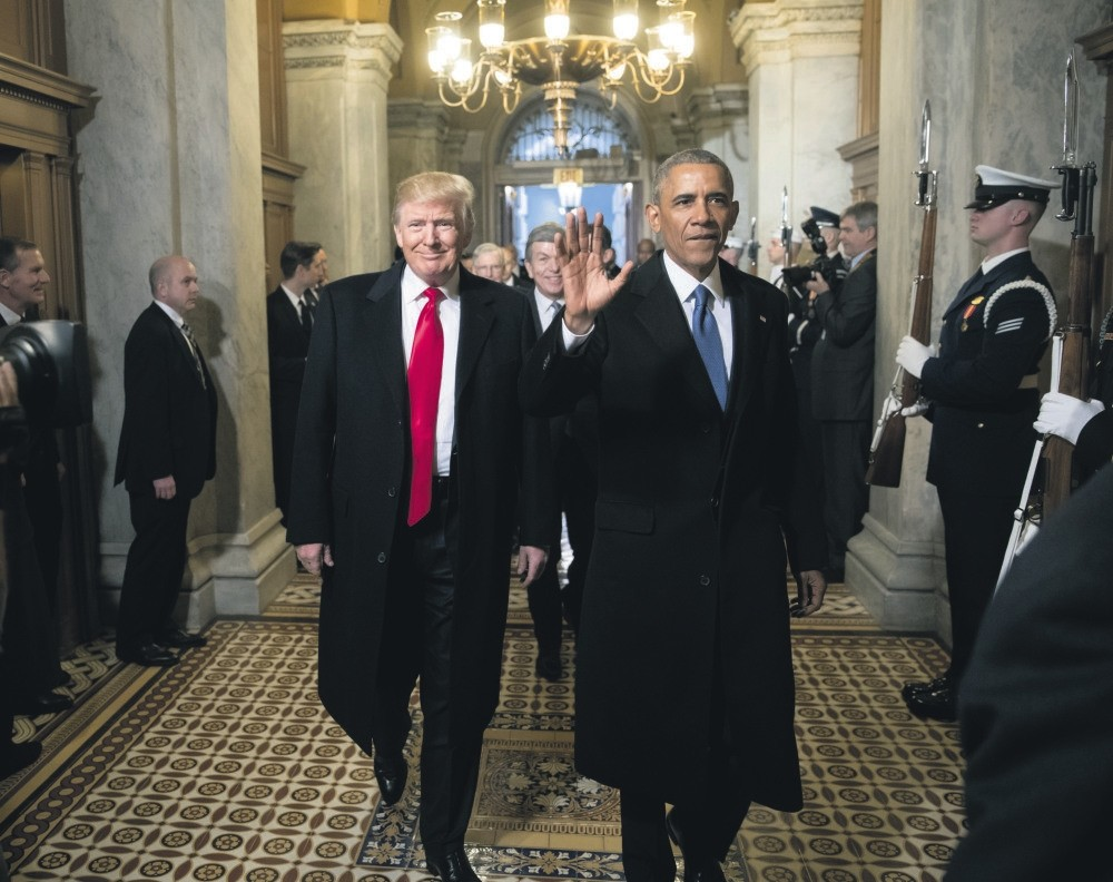 Then-President-elect Donald Trump and then-President Barack Obama arrive for Trump's inauguration ceremony at the Capitol, Washington, Jan. 20, 2017.