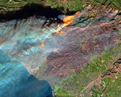 A NASA handout photo shows a false-color image captured by the Multi Spectral Imager (MSI) on the European Space Agency (ESA)'s Sentinel-2 satellite of the burn scar of the Thomas fire in Ventura County, California, Dec. 5, 2017. (EPA Photo)