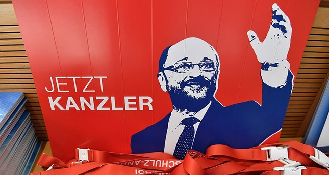 A placard featuring SPD chairman and candidate for chancellery Martin Schulz reading now chancellor and campaigning material is displayed on August 1, 2017 at the Social Democrats Party headquarters in Berlin. (AFP Photo)