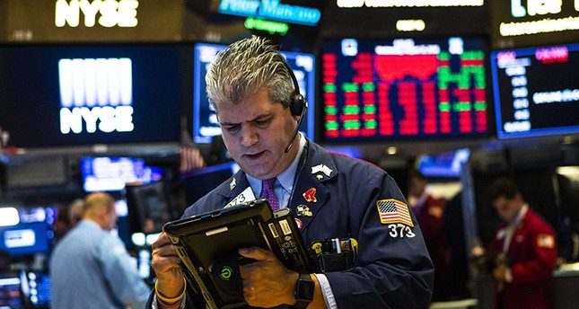 US stocks tumble, lira surges as Turkey hits back