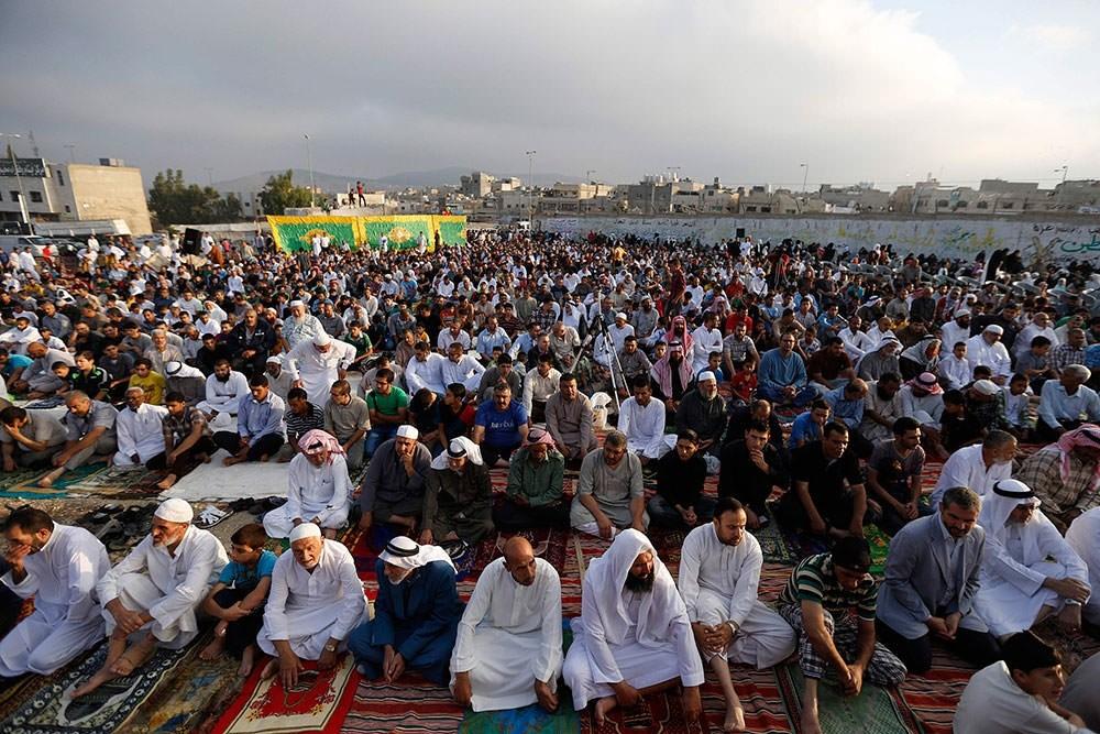 Palestinian refugees perform Eid al-Fitr prayers at Al-Baqaa Palestinian refugee camp