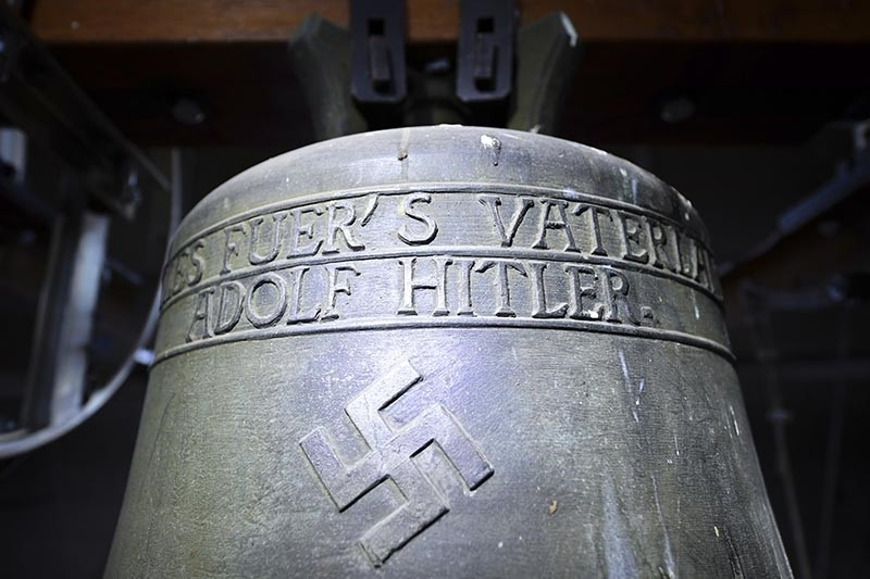 In this May 19, 2017 file photo a bell a church bell with the inscription ,Everything for the fatherland Adolf Hitler, and a swastika is pictured in the town church in Herxheim am Berg (AP Photo)