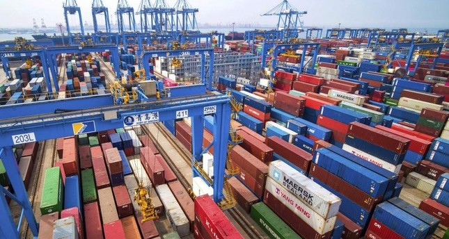 In this May 14, 2019, file photo, containers are piled up at a port in Qingdao in east China's Shandong province. (AP Photo)