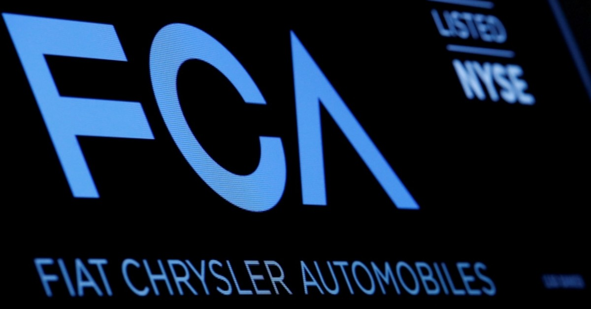 A screen displays the ticker information for Fiat Chrysler Automobiles NV at the post where it's traded on the floor of the New York Stock Exchange (NYSE) in New York City, U.S (Reuters Photo)