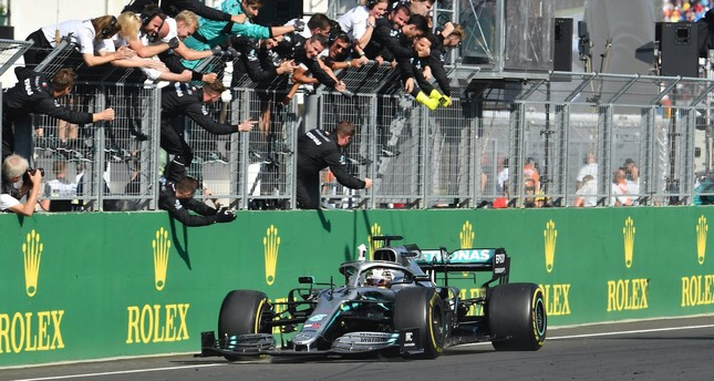 Mercedes' British driver Lewis Hamilton celebrates with his teammates after winning the Formula One Hungarian Grand Prix at the Hungaroring circuit in Mogyorod near Budapest, Hungary, Aug. 4, 2019.