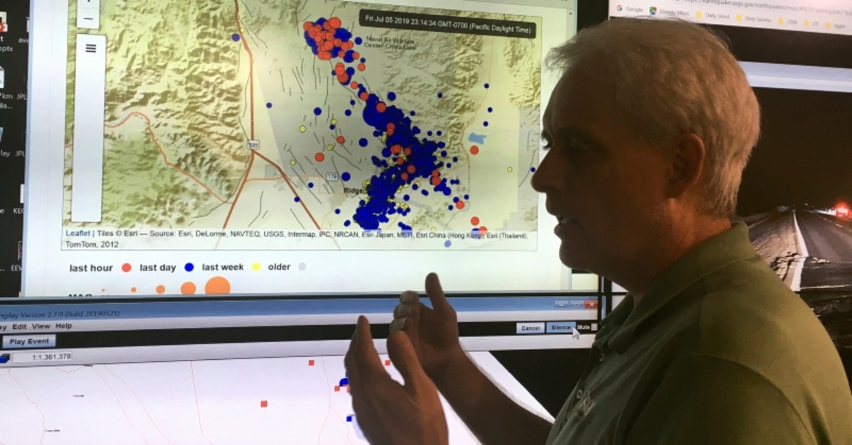 Robert Graves, a seismologist from the U.S. Geological Survey, stands in front of a display of earthquakes in Searles Valley during a news conference at the California Institute of Technology in Pasadena, Calif., Friday evening, July 5. (AP Photo)