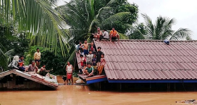 Villagers evacuate after the Xepian-Xe Nam Noy hydropower dam collapsed in Attapeu province, Laos July 24, 2018. Reuters Photo