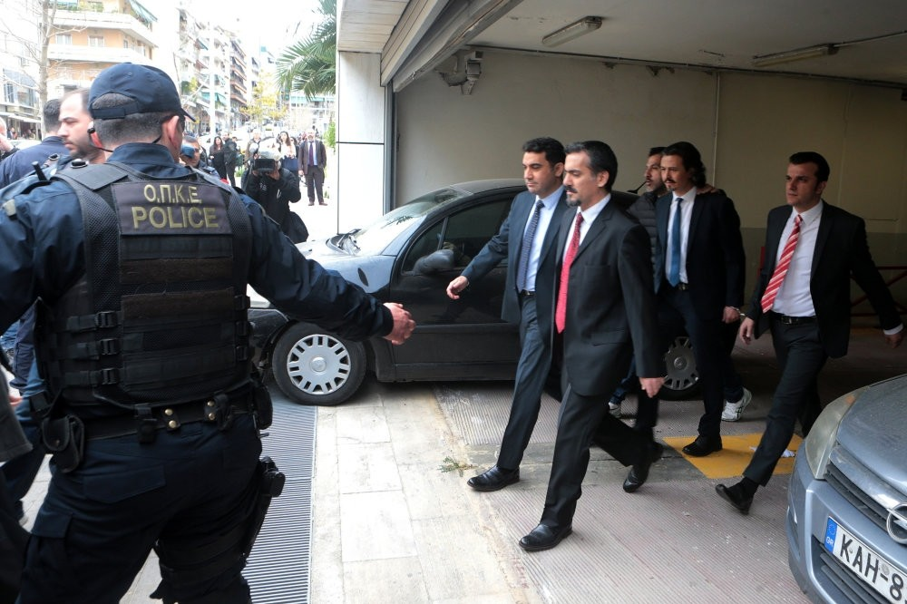Greek police officers escort eight Turkish putschist officers out of a courthouse in Athens in March. They were the first group of suspects, wanted by Turkey for links to the 2016 coup attempt, to take shelter in Greece.