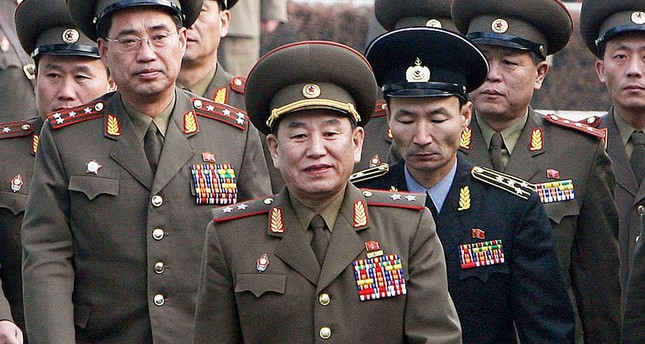 This file picture taken on December 13, 2007 shows North Korea's chief delegate Kim Yong Chol (C) and North Korean soldiers crossing the border which divides the two Koreas. (AFP Photo)