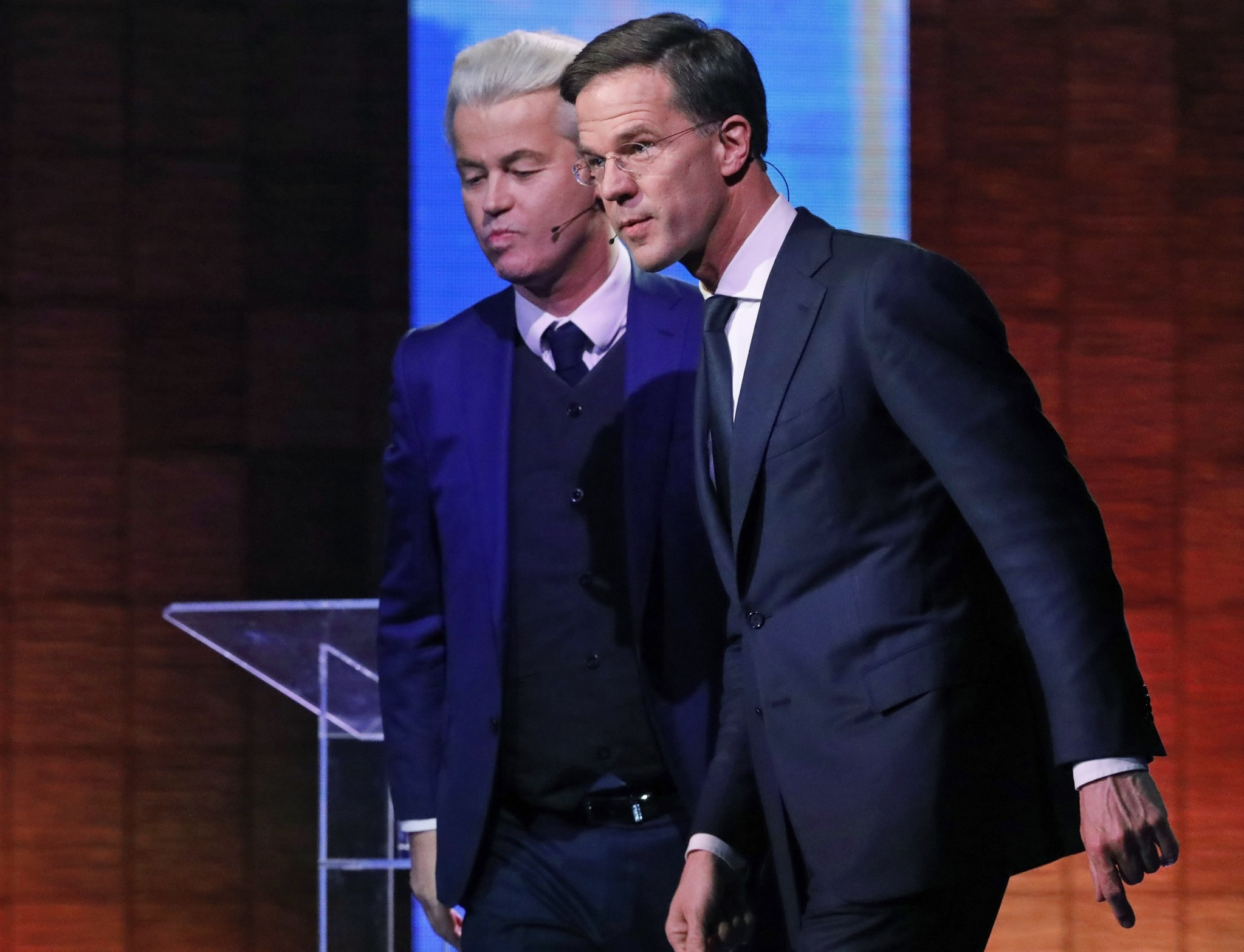 Dutch Prime Minister Mark Rutte, right, and Right-wing populist leader Geert Wilders leave after a national televised debate. (AP Photo)