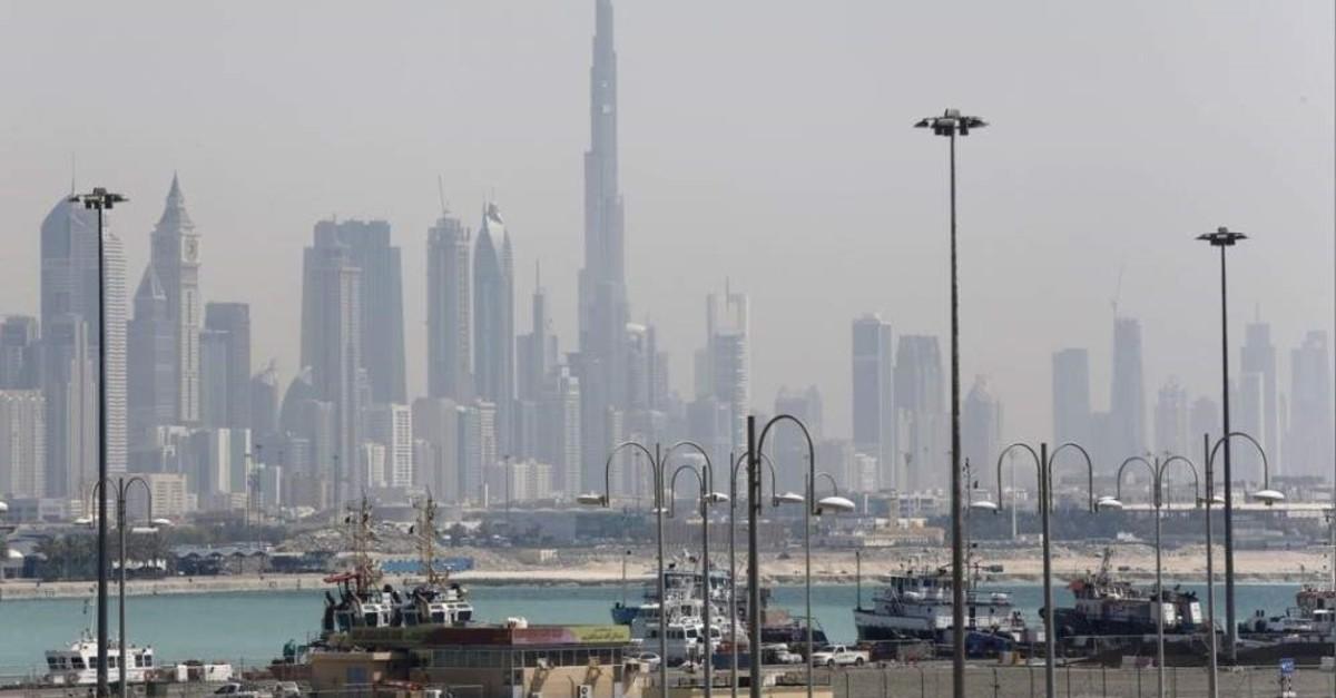 The skyline is seen with the Burj Khalifa as ships dock at Port Rashid, Dubai, May 26, 2013. (Reuters Photo)