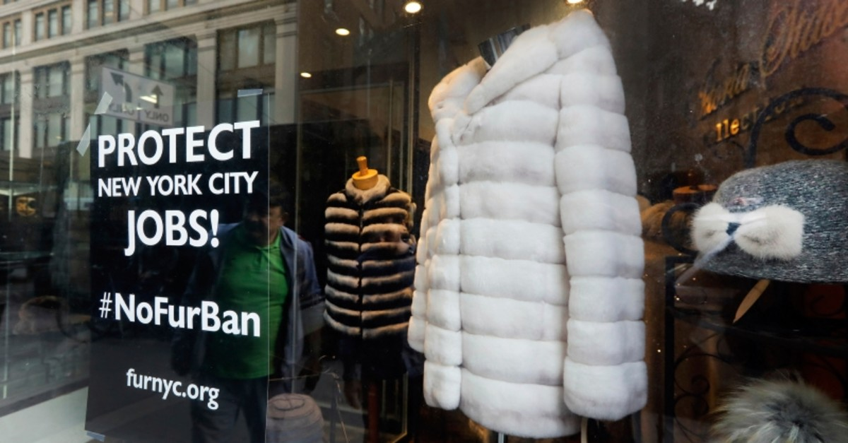 This April 10, 2019, photo shows a sign by furnyc.org in the window of Victoria Stass Collection in New York's fur district (AP Photo)