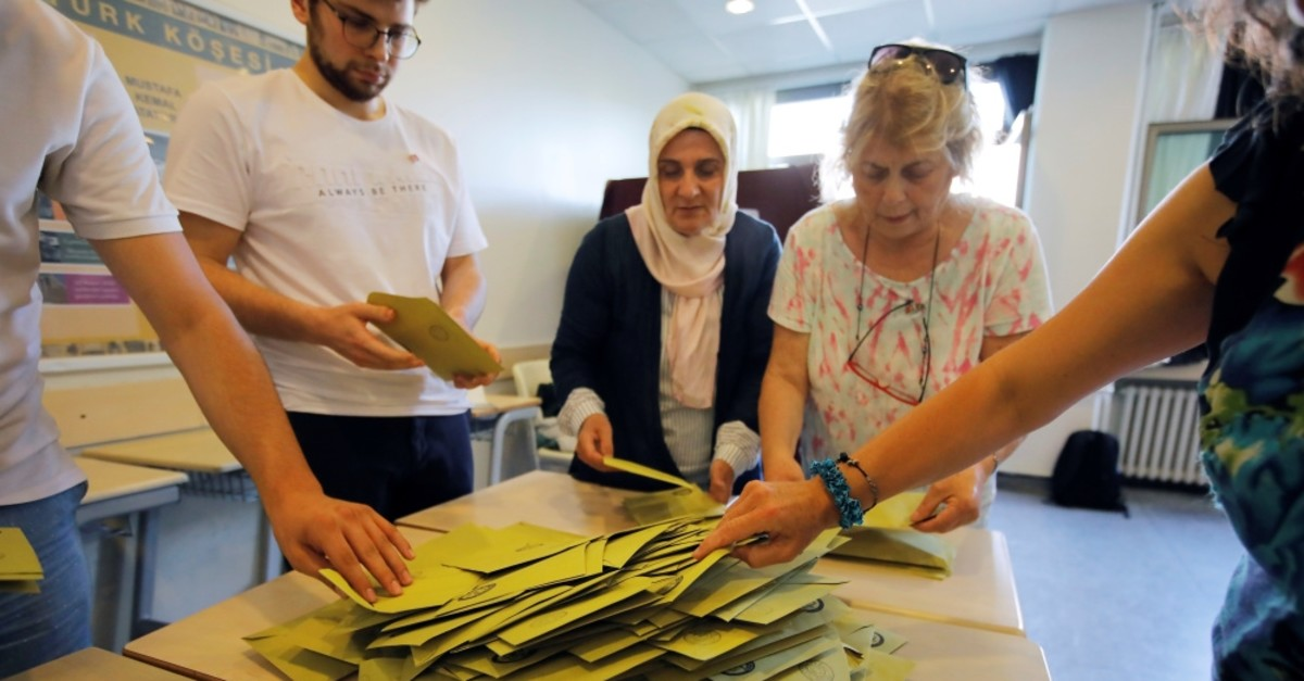 Election officials open a ballot box to count votes at a polling station in Istanbul, June 23, 2019.