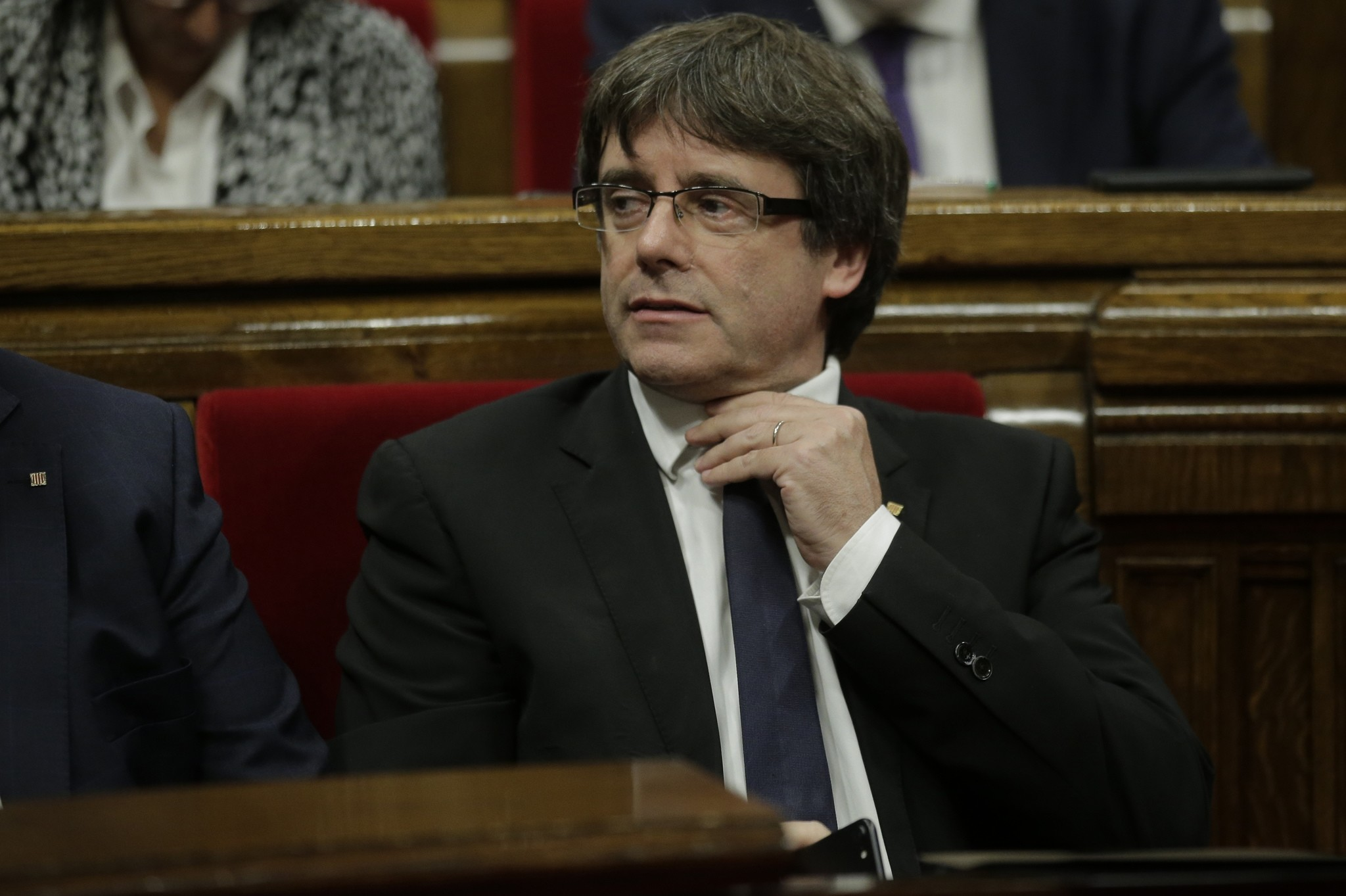 Catalan regional President Carles Puigdemont waits to make his opening speech at the parliament in Barcelona, Spain, Tuesday, Oct. 10, 2017. (AP Photo)