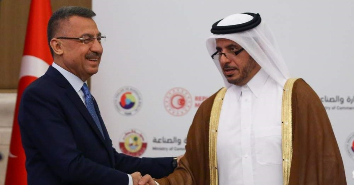 Vice President Fuat Oktay (L) and Qatari Prime Minister and Interior Minister Abdullah bin Nasser bin Khalifa Al Thani shake hands during the Turkey-Qatar Business Forum in Ankara, Nov. 1, 2019. (?HA Photo)