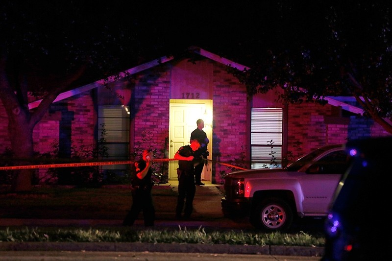 Police officers work the scene of a shooting at a home in Plano, north of Dallas, Texas, Sunday night, Sept. 10, 2017 (AP Photo)