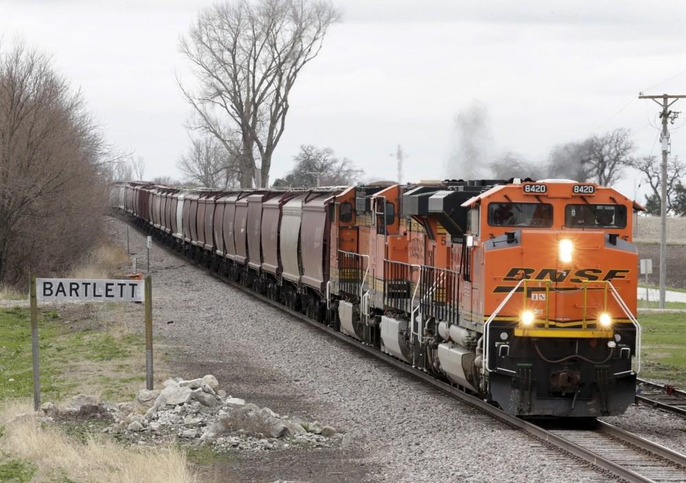 A BNSF Railway train transporting grain passes through Bartlett, Iowa.