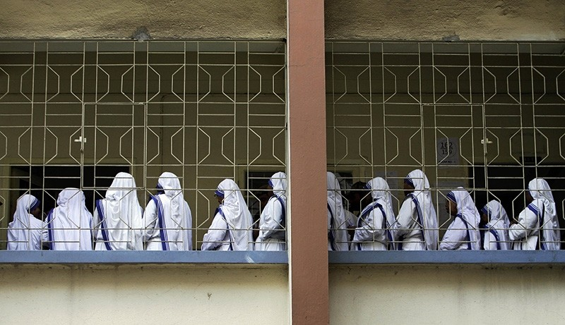 In this April 27, 2011 file photo, nuns of Missionaries of Charity, the order founded by Mother Teresa, stand in a queue to cast their vote during West Bengal state assembly elections in Kolkata, India. (AP Photo)