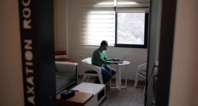 In this Nov. 16, 2015 file photo, a Palestinian employee takes a break in the relaxation room at the office of the sartup firm Haweya for Information Technology, in Gaza City. (AP Photo)
