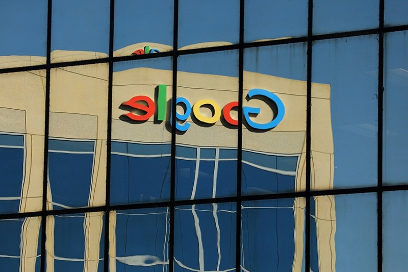 The Google logo is shown reflected on an adjacent office building in Irvine, California, U.S. August 7, 2017. (Reuters Photo)