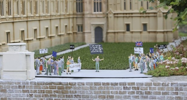 Miniature demonstrators for Brexit are seen in front of a miniature of British Parliament in Mini-Europe miniature park in Brussels.