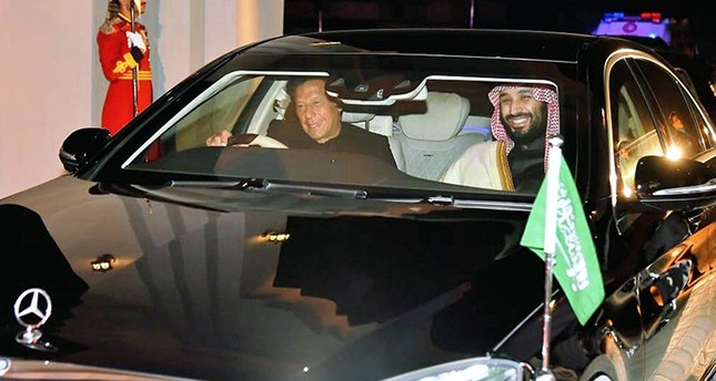 In this photo released by the Press Information Department, Pakistani Prime Minister Imran Khan, left, with Saudi Arabia's Crown Prince Mohammed bin Salman, right, leave from Nur Khan airbase in Rawalpindi, Pakistan, Feb. 17, 2019. (AP Photo)