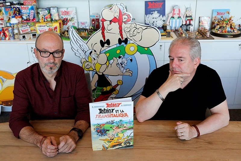 Author Jean-Yves Ferri (L) and illustrator Didier Conrad stand next to a copy of their new comic album ,Asterix et la Transitalique, (Asterix and the Chariot Race) during an interview in Vanves near Paris, France, October 17, 2017. (Reuters Photo)