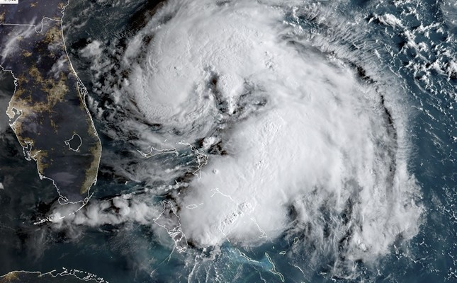 This satellite image obtained from NOAA/RAMMB, shows Tropical Storm Humberto as it moves near the Bahamas at 12:00UTC on Sept. 15, 2019. (AFP Photo)