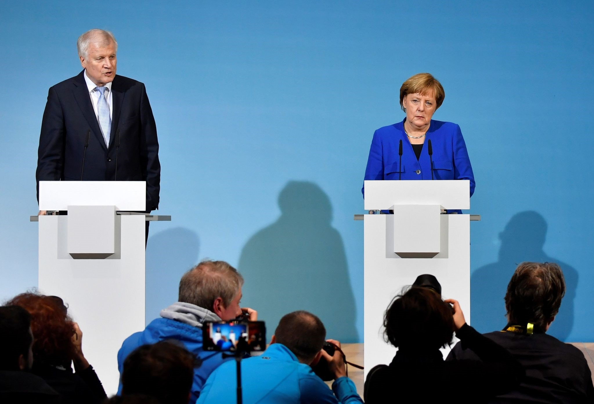 State Premier for the state of Bavaria and leader of the Christian Social Union (CSU) Horst Seehofer and German Chancellor Angela Merkel attend a press conference after talks to form a new government, Berlin, Jan. 12.