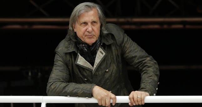 In this Monday, May 23, 2016 file picture, former Romanian tennis ace Ilie Nastase watches a match of the French Open tennis tournament at the Roland Garros stadium, in Paris, France. (AP Photo)