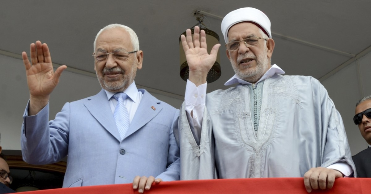 Vice President of the Ennahda party Abdelfattah Mourou (R) and party leader Rachid Ghannouchi wave from the party headquarters, Tunis, Sept. 9, 2019.