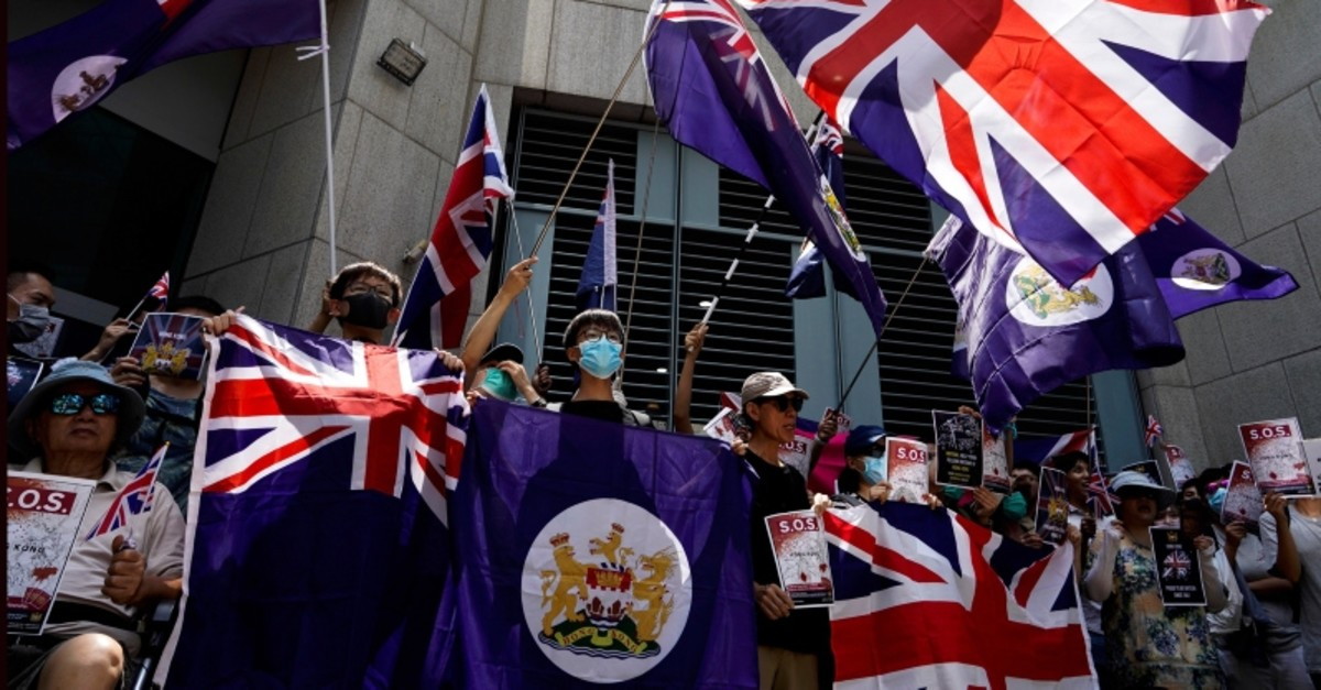 Protesters wave British flags during a peaceful demonstration outside the British Consulate in Hong Kong, Sunday, Sept. 15, 2019. (AP Photo)