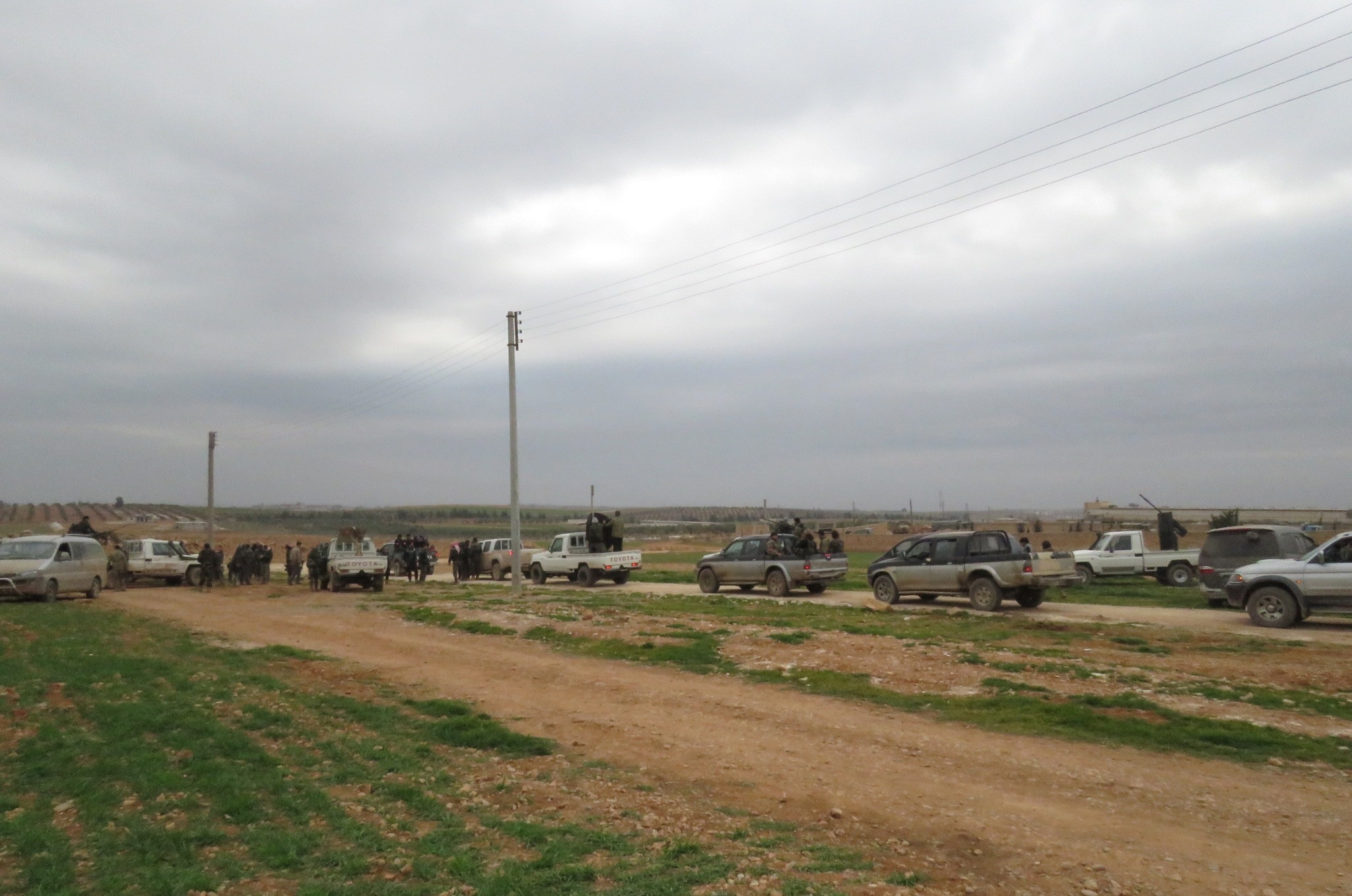 Armed vehicles of Free Syrian Army (FSA) forces, which have been carrying out Operation Euphrates Shield backed by the Turkish military against Daesh terrorists in Syrian towns since Aug. 24, 2016, standing in a western village of al-Bab, Feb. 12.