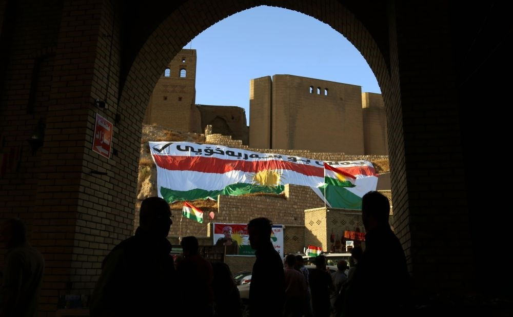 Iraqis walk in the square in a citadel in Irbil, Iraq on Sept. 23.