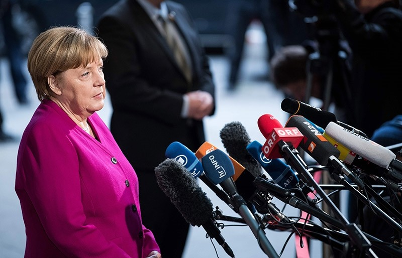 German Chancellor Angela Merkel gives a statement prior to a meeting with the leaders of the conservative CDU/CSU union and the social democratic SPD party in Berlin. (AFP Photo)