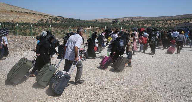 Syrians head to the Cilvegözü border crossing in Hatay as thousands flock home for Eid al-Fitr.