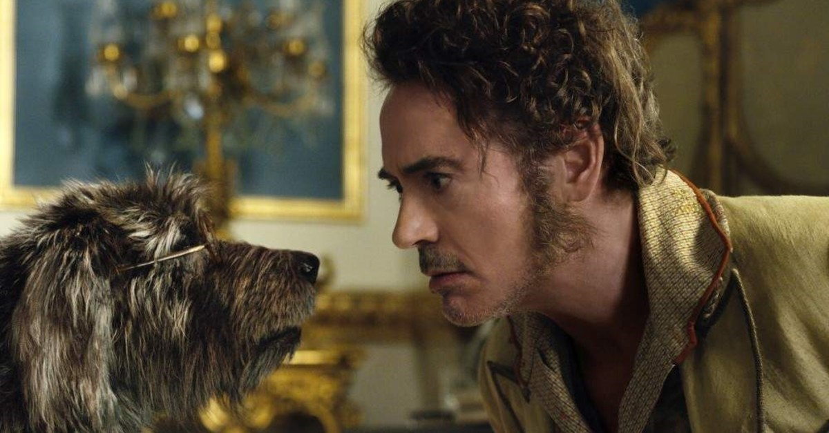 This image released by Universal Pictures shows Dr. John Dolittle, portrayed by Robert Downey Jr., right, with Jip, voiced by Tom Holland, in a scene from ,Dolittle., (AP Photo)