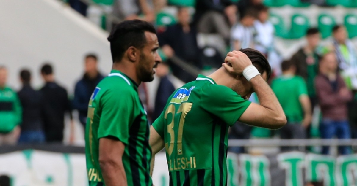 Akhisarspor players Sokol Chikalleshi and Sergio Borges (L) walk in frustration after a 2-0 loss to Evkur Yeni Malatyaspor, May 5, 2019.