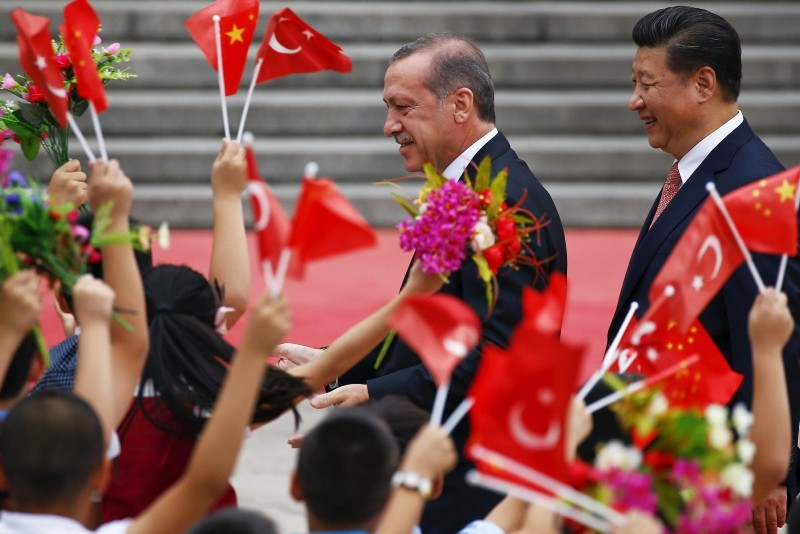 President Recep Tayyip Erdou011fan (L) and his Chinese counterpart Xi Jinping greet children waving their country's national flags during a welcoming ceremony outside the Great Hall of the People in Beijing July 29, 2015. (Reuters Photo)