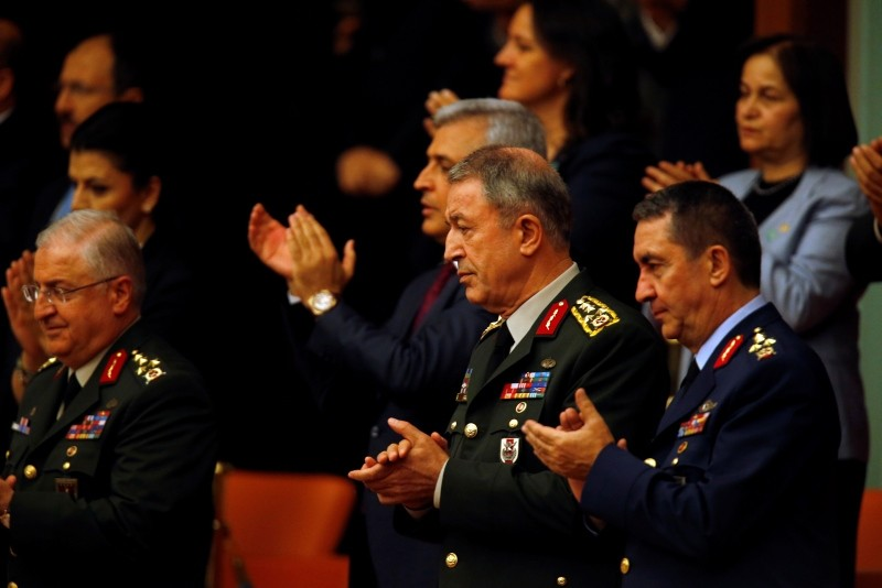 Hulusi Akar, centre, Turkey's Chief of the General Staff, accompanied by other military commanders applaud from the gallery after Erdoğan took the oath of office for his second term as president, at the parliament in Ankara, Turkey, Monday, July 9, 2018