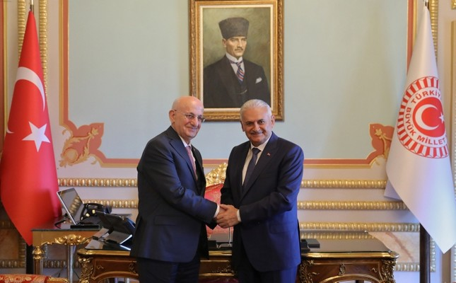PM Binali Yıldırım (R) and retiring Parliament Speaker Binali Yıldırım. (AA Photo)