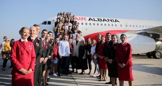 Albanian Prime Minister Edi Rama, Albanian ministers and Turkish Ambassador Murat Ahmet Yörük pose alongside the staff of the newly-established Air Albania after its maiden flight at the Tirana Mother Teresa Airport, on Sept. 15, 2019. (AA Photo)