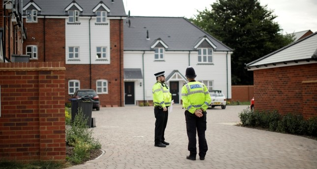 British police officers stand outside a residential property in Amesbury, England, Wednesday, July 4, 2018. (AP Photo)