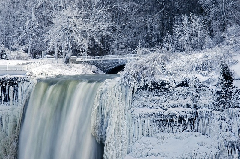 Almost every year frigid temperatures transform Niagara Falls State Park into an icy winter wonderland when the mist of the falls is blown back, freezing on the landscape.